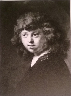 Portrait of a boy with long hair