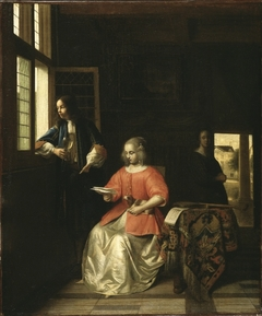Woman reading a letter and a man at a window