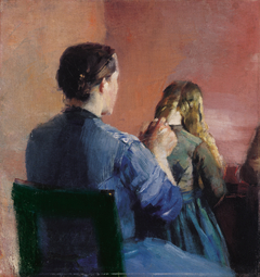 A mother plainting her little daughter's hair