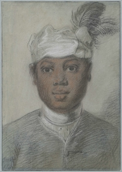Hoofd van een zwarte jongeman met tulband met veren