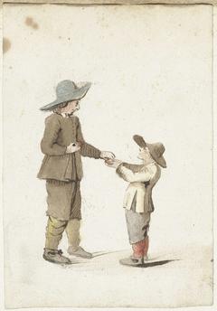 Jongen geeft een appel aan een jongere jongen
