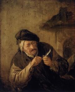Old Man Mending his Pen