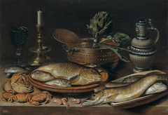 Still life of fish with a candlestick