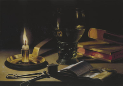 Still life with a lighted candle