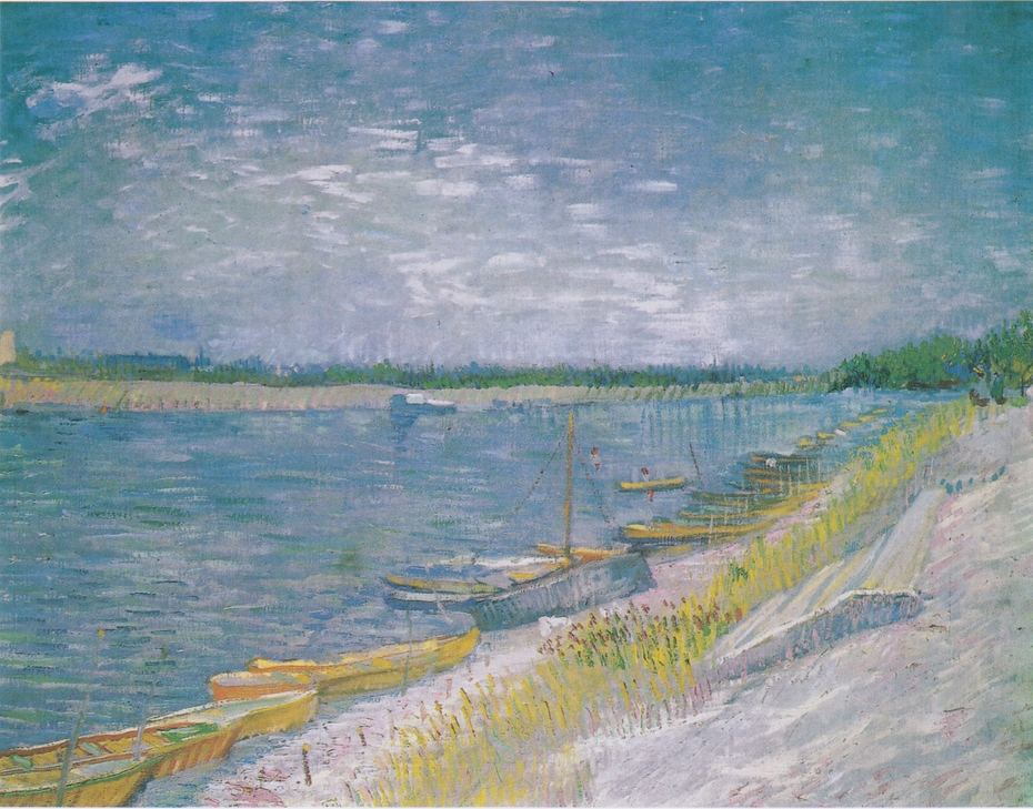River landscape with rowing boats on the shore