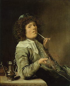 A smoking man with an empty wine glass