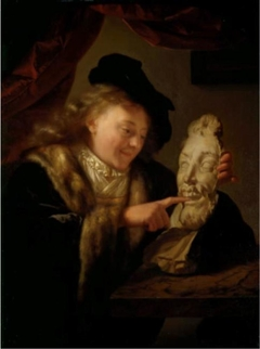 Boy playing with a plaster mask