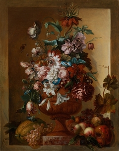 Flowers in a vase set in a stone niche