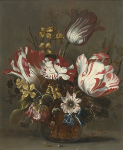 Tulips and other flowers in a glass vase