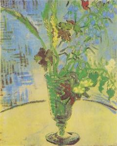 Glass with wild flowers