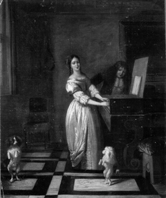 Woman playing the virginal with a man and two dancing dogs