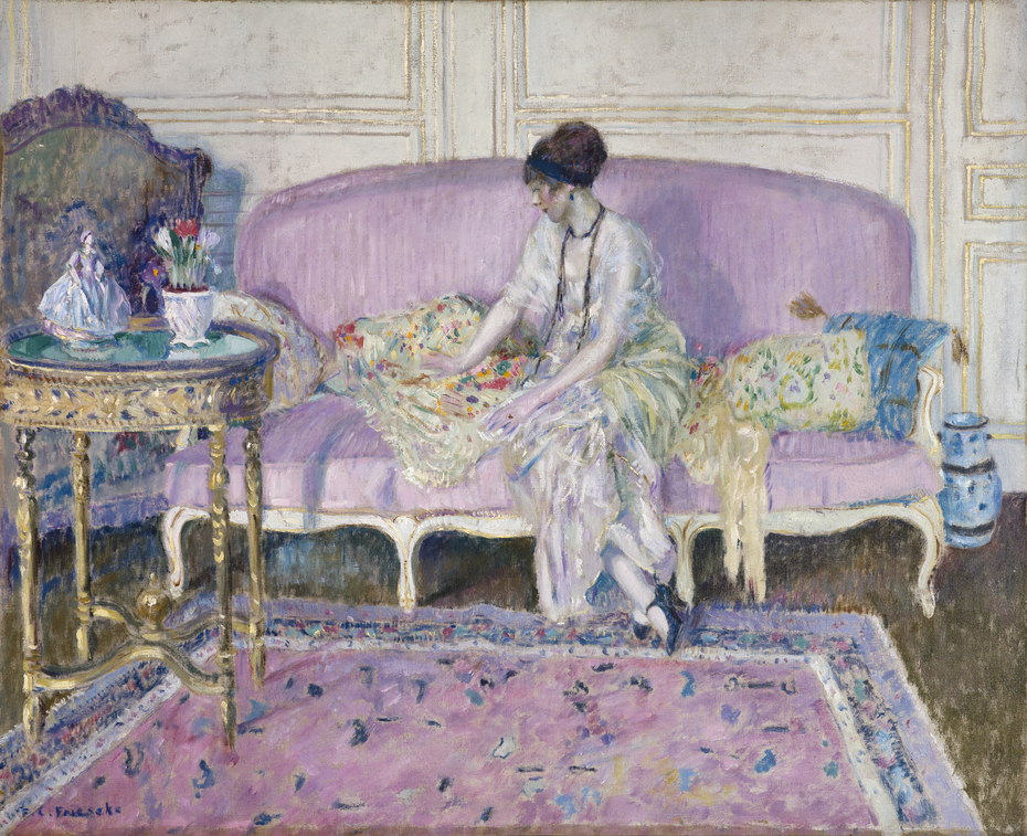 Woman Seated on Sofa in Interior